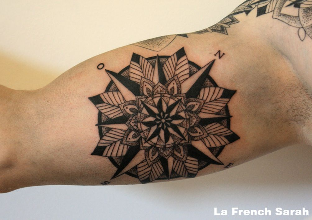 Tatuaje de mandala en el brazo